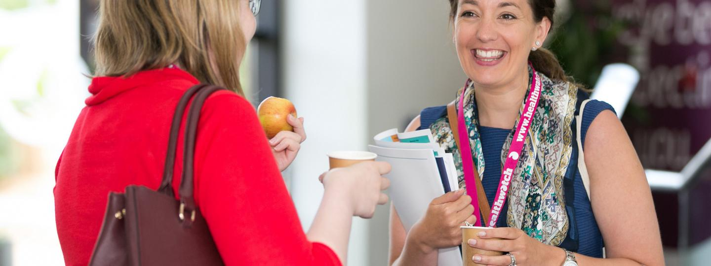 Healthwatch staff members talking to one another
